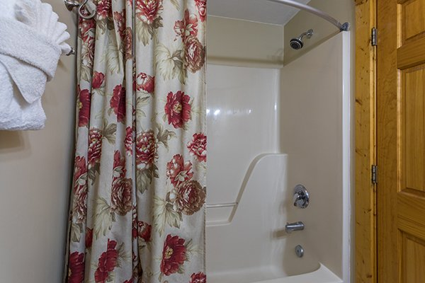 Bathroom with a tub and shower at Mountain Escape, a 2 bedroom cabin rental located in Pigeon Forge