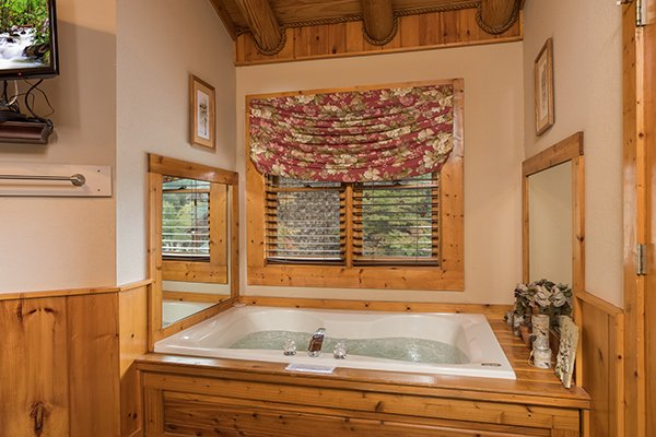Jacuzzi tub in a bedroom at Mountain Escape, a 2 bedroom cabin rental located in Pigeon Forge