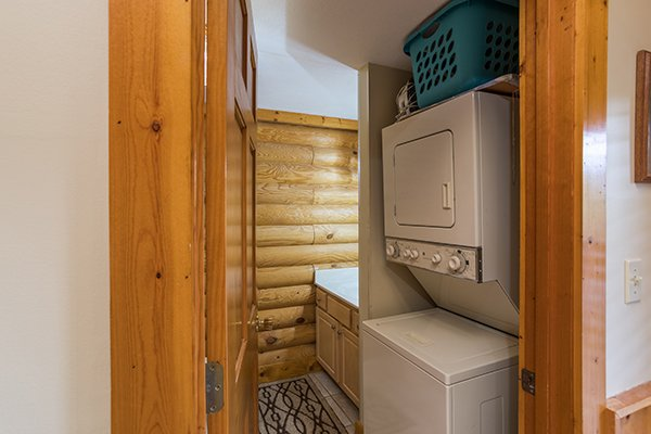 Stacked washer and dryer at Mountain Escape, a 2 bedroom cabin rental located in Pigeon Forge
