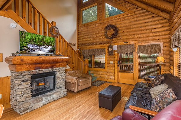 Living room with fireplace and TV at Mountain Escape, a 2 bedroom cabin rental located in Pigeon Forge