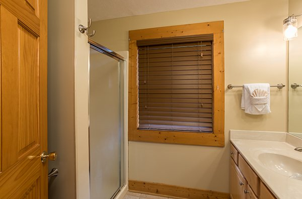 Bathroom with a shower stall on the lower level at Mountain Escape, a 2 bedroom cabin rental located in Pigeon Forge