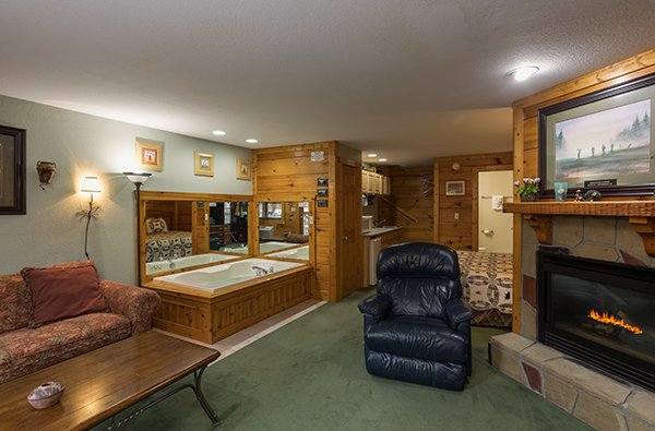 Lower level den with a fireplace at Mountain Escape, a 2 bedroom cabin rental located in Pigeon Forge