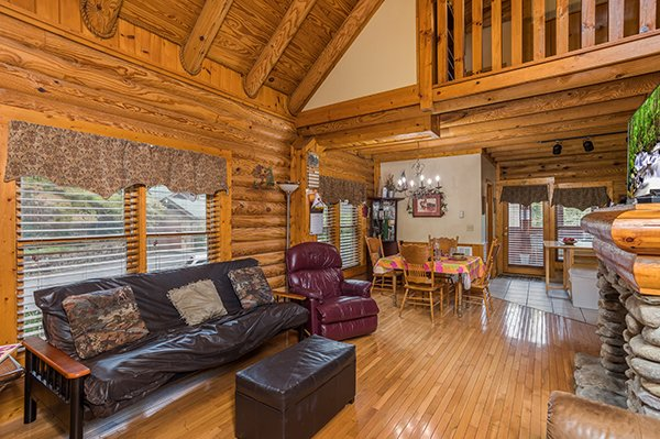 Main floor with a living room, dining space, and kitchen at Mountain Escape, a 2 bedroom cabin rental located in Pigeon Forge