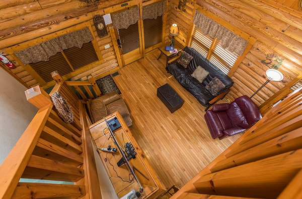 Looking down onto the living room from the upper floor at Mountain Escape, a 2 bedroom cabin rental located in Pigeon Forge