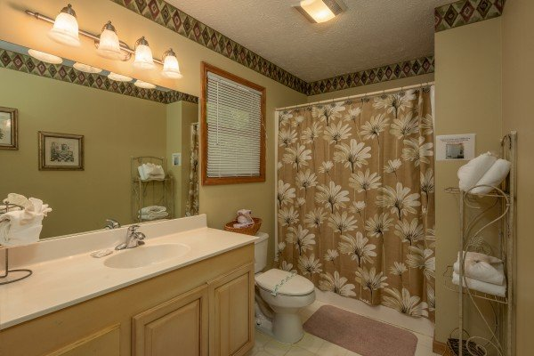 Bathroom with a tub and shower at Amazing Memories, a 3 bedroom cabin rental located in Pigeon Forge