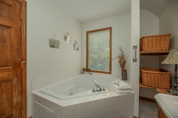 Corner jacuzzi tub at Amazing Memories, a 3 bedroom cabin rental located in Pigeon Forge