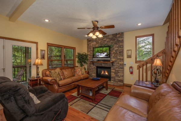 Living room with fireplace and TV at Amazing Memories, a 3 bedroom cabin rental located in Pigeon Forge