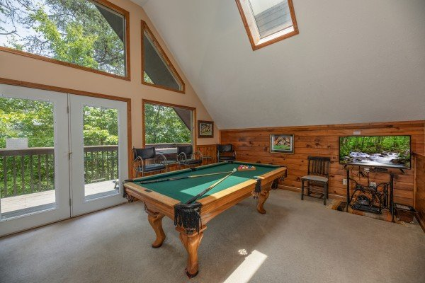 Pool table in the game loft at Amazing Memories, a 3 bedroom cabin rental located in Pigeon Forge