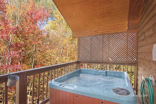 Covered hot tub at Mountain Manor, a 1 bedroom cabin rental located in Gatlinburg