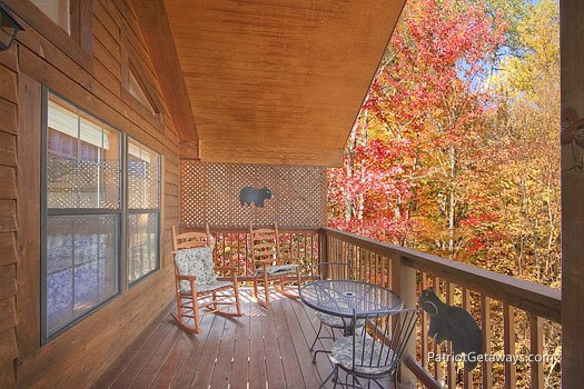 Deck with rocking chairs at Mountain Manor, a 1 bedroom cabin rental located in Gatlinburg
