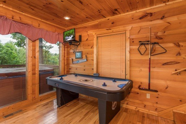 Air hockey table and TV at Serenity Heights, a 3 bedroom cabin rental located in Pigeon Forge