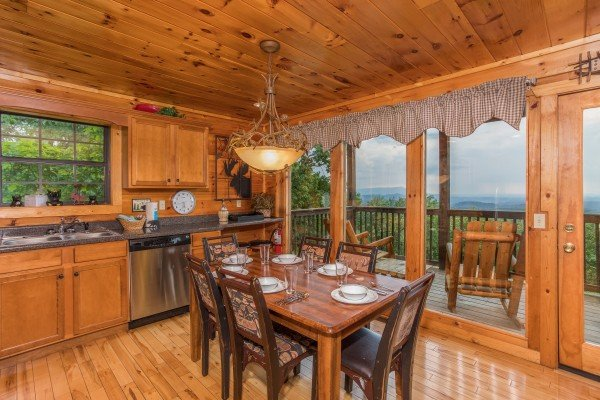 Dining space for six at Serenity Heights, a 3 bedroom cabin rental located in Pigeon Forge