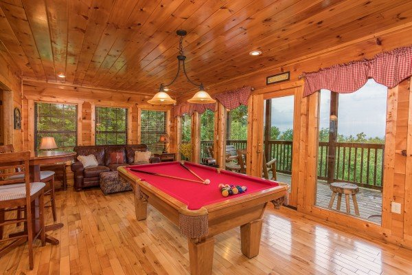 Pool table and deck access at Serenity Heights, a 3 bedroom cabin rental located in Pigeon Forge