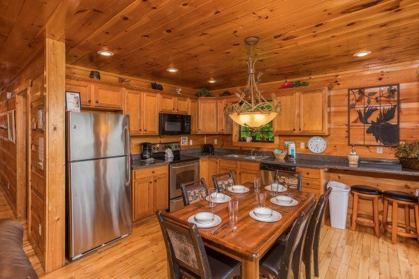Kitchen with stainless appliances and dining space for six at Serenity Heights, a 3 bedroom cabin rental located in Pigeon Forge
