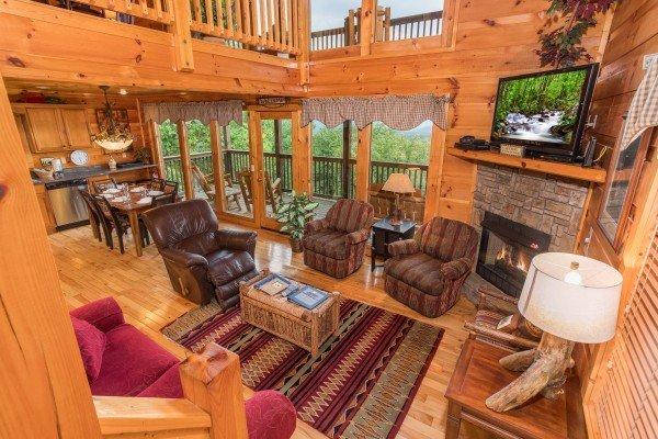 Living room, dining room, and kitchen at Serenity Heights, a 3 bedroom cabin rental located in Pigeon Forge