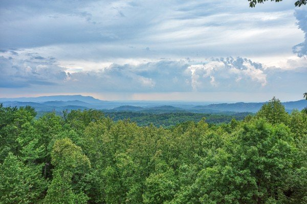 Looking out onto the Smoky Mountains at Serenity Heights, a 3 bedroom cabin rental located in Pigeon Forge