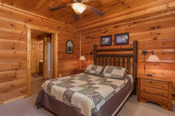 Queen bedroom with two nightstands at Serenity Heights, a 3 bedroom cabin rental located in Pigeon Forge