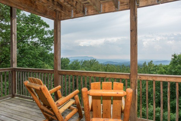 Rocking chairs on the lower deck at Serenity Heights, a 3 bedroom cabin rental located in Pigeon Forge