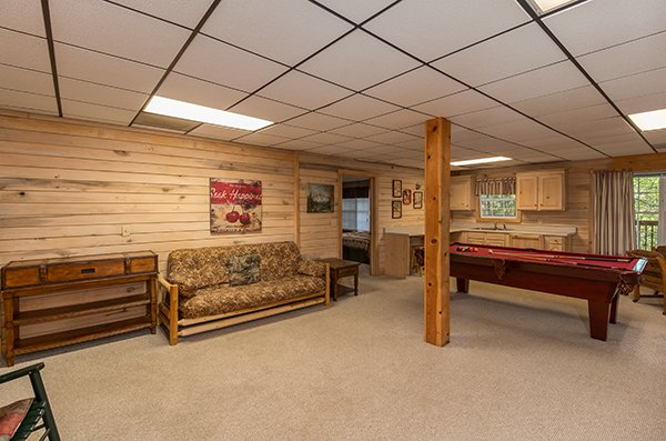 Futon in the game room at On Angels Wings, a 5 bedroom cabin rental located in Gatlinburg