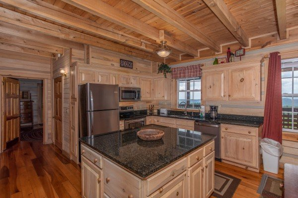 Kitchen with stainless appliances and granite counters On Angels Wings, a 5 bedroom cabin rental located in Gatlinburg