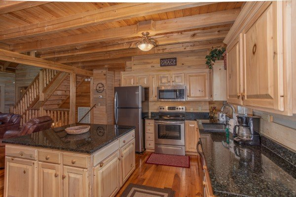 Kitchen with stainless appliances and black granite counters On Angels Wings, a 5 bedroom cabin rental located in Gatlinburg