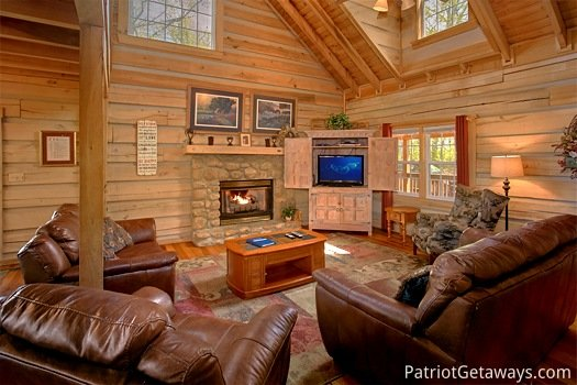 Living room with stone fireplace at On Angels Wings, a 5 bedroom cabin rental located in Gatlinburg