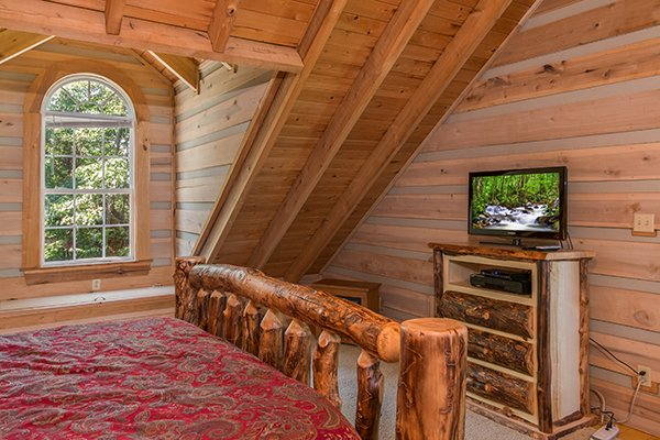 Bedroom with a dresser and TV On Angels Wings, a 5 bedroom cabin rental located in Gatlinburg