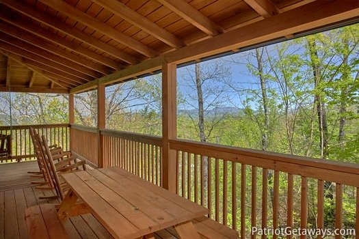 Picnic table on the deck at On Angels Wings, a 5 bedroom cabin rental located in Gatlinburg
