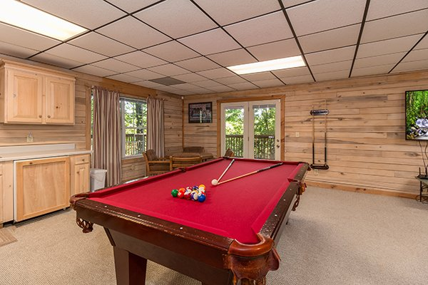 Pool table and kitchenette on the lower level at On Angels Wings, a 5 bedroom cabin rental located in Gatlinburg