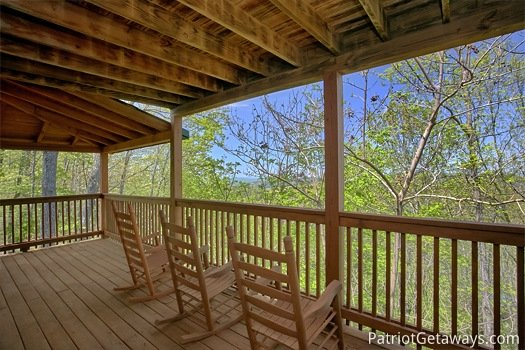 rocking chairs on wrap around deck at on angels wings a 5 bedroom cabin rental located in gatlinburg