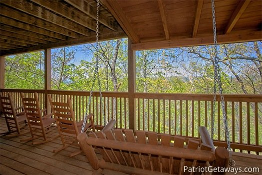 swing and rockers on the deck at on angels wings a 5 bedroom cabin rental located in gatlinburg