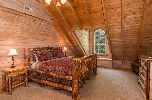 Bedroom with a king log bed at On Angels Wings, a 5 bedroom cabin rental located in Gatlinburg