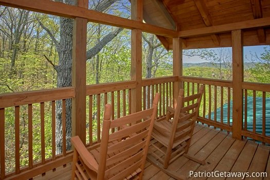 Rockers with Smoky Mountain views from the deck at On Angels Wings, a 5 bedroom cabin rental located in Gatlinburg
