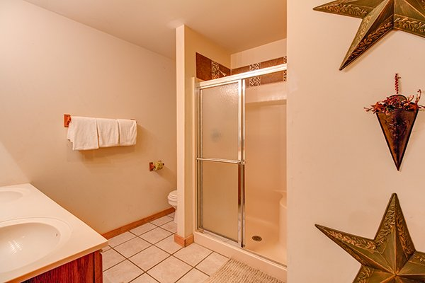 Bathroom with a separate shower at Just for Fun, a 4 bedroom cabin rental located in Pigeon Forge