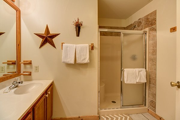 Bathroom with a walk in shower at Just for Fun, a 4 bedroom cabin rental located in Pigeon Forge