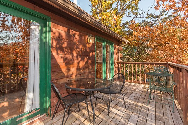 Deck dining space at Just for Fun, a 4 bedroom cabin rental located in Pigeon Forge