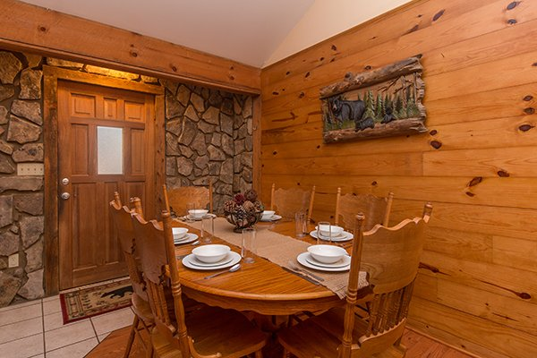 Dining room just off the main entrance with seating for six at Just for Fun, a 4 bedroom cabin rental located in Pigeon Forge
