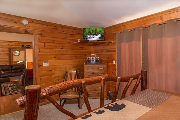 Bedroom with a dresser, CD player, and TV at Just for Fun, a 4 bedroom cabin rental located in Pigeon Forge
