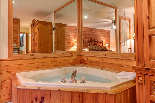 Corner in room jacuzzi tub at Just for Fun, a 4 bedroom cabin rental located in Pigeon Forge