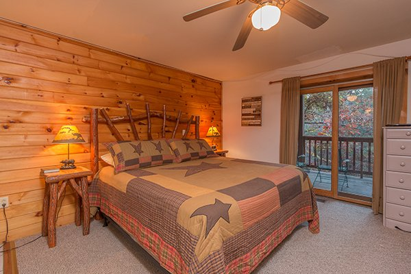 Bedroom with a wood bed and two night stands at Just for Fun, a 4 bedroom cabin rental located in Pigeon Forge
