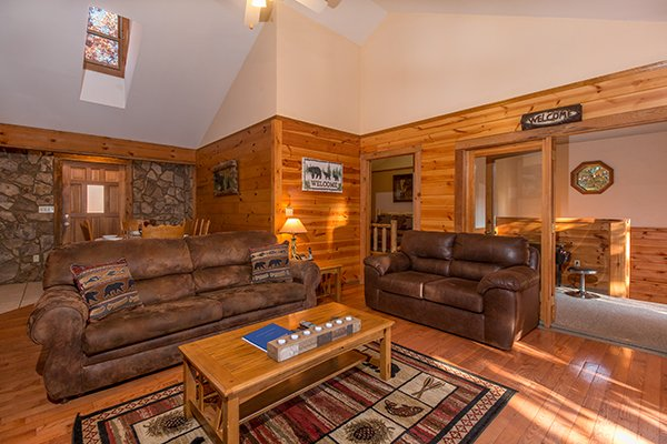 Living room with a sofa and loveseat at Just for Fun, a 4 bedroom cabin rental located in Pigeon Forge