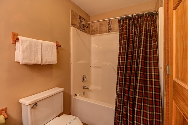 Bathroom with a tub and shower at Just for Fun, a 4 bedroom cabin rental located in Pigeon Forge