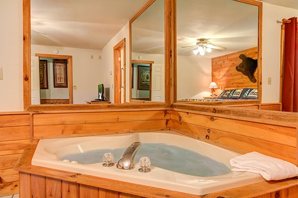 A corner in room jacuzzi at Just for Fun, a 4 bedroom cabin rental located in Pigeon Forge