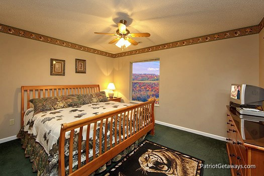 third floor bedroom with king bed at smoky mountain lodge a 7 bedroom cabin rental located in gatlinburg
