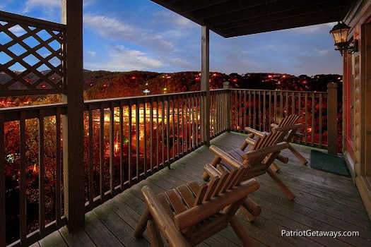 covered deck with chairs at smoky mountain lodge a 7 bedroom cabin rental located in gatlinburg