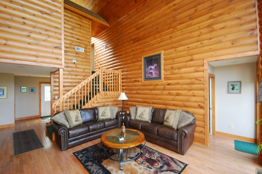living room staircase at smoky mountain lodge a 7 bedroom cabin rental located in gatlinburg