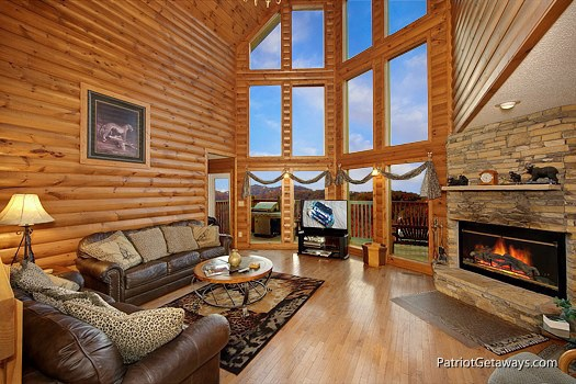 living room with fireplace at smoky mountain lodge a 7 bedroom cabin rental located in gatlinburg