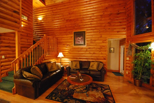 liviing room with sleeper sofa at smoky mountain lodge a 7 bedroom cabin rental located in gatlinburg