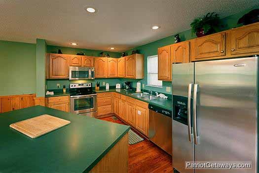 kitchen with stainless steel appliances at smoky mountain lodge a 7 bedroom cabin rental located in gatlinburg