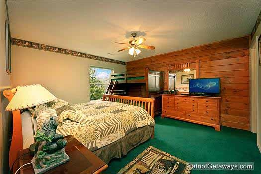 lower level bedroom at smoky mountain lodge a 7 bedroom cabin rental located in gatlinburg
